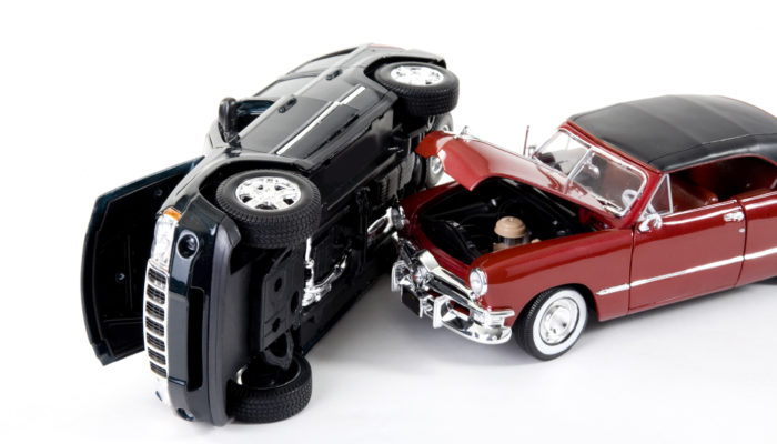 close up of collectible car over white background